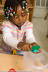 preschool 2-4 year olds art activity play dough girl cutting play dough with plastic implement