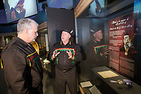 Quebec premier Philippe Couillard, left, looks at Konrad Sioui, Grand Chef of the Huron-Wendat nation, as he talks about a treaty between the Huron and the British on display at the Hotel-Musee in Wendake, a Huron reserve enclave within Quebec City, Thursday July 17, 2014.<br /> <br /> PHOTO :  Francis Vachon - Agence Quebec Presse