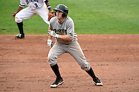 Dayton Dragons third baseman Tanner Rahier (9) on the base path during a game against the Lake County Captains on June 8, 2014 at Classic Park in Eastlake, Ohio.  Lake County defeated Dayton 4-2.  (Mike Janes/Four Seam Images)