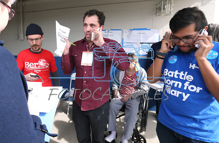 From left, Todd Sorensen, with the Bernie Sanders campaign, Precinct Chair Scott Baez and Ben Mendez, site leader for Hillary Clinton, work to clarify the caucus count during the Democratic Caucus at Libby Booth Elementary School, in Reno, Nev. on Saturday, Feb. 20, 2016. Cathleen Allison/Las Vegas Review-Journal