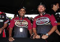 Jun. 2, 2012; Englishtown, NJ, USA: NHRA top fuel dragster driver Shawn Langdon (right) and teammate Khalid Albalooshi during qualifying for the Supernationals at Raceway Park. Mandatory Credit: Mark J. Rebilas-