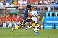 Santa Clara, CA - Friday June 03, 2016: Colombia midfielder Juan Cuadrado (11) is marked by United States defender DeAndre Yedlin (2) during a Copa America Centenario Group A match between United States (USA) and Colombia (COL) at Levi's Stadium.
