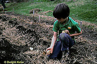 HS05-014b   Potato - child planting potatoes
