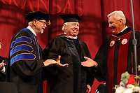 NWA Democrat-Gazette/ANDY SHUPE<br /> William Dillard (center) smiles Saturday, May 13, 2017, alongside Ben Hyneman (right), chair of the Board of Trustees of the University of Arkansas System, and Joseph Steinmetz (left), chancellor, after Dillard was awarded an honorary degree during commencement exercises in Bud Walton Arena in Fayetteville. Visit nwadg.com/photos to see more photographs from the ceremony.