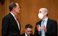 """United States Senator Pat Toomey (Republican of Pennsylvania), Ranking Member, US Senate Committee on Banking, Housing, and Urban Affairs, left, speaks with Gary Gensler, Chair of the U.S. Securities and Exchange Commission, before the start of the Senate Banking, Housing, and Urban Affairs Committee hearing on """"Oversight of the U.S. Securities and Exchange Commission"""" on Tuesday, Sept. 14, 2021. <br /> Credit: Bill Clark / Pool via CNP /MediaPunch"""