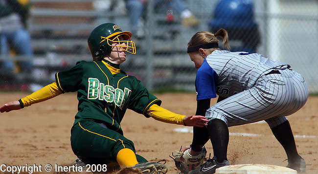 SIOUX FALLS, SD - APRIL 28: Laurel Pipkin #1, of North Dakota State University safely steals second as Greta Stroh #3, of South Dakota State University catches the ball in the second inning Monday afternoon in game two of their doubleheader at Bowden Field in Sioux Falls. The game was moved from Brookings, due to unplayable field conditions. (Photo by Dave Eggen/Inertia)