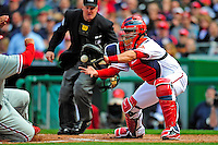 13 April 2009: Washington Nationals' catcher Jesus Flores is unable to make the tag on a sliding Raul Ibanez in the second inning against the Philadelphia Phillies during the Nats' Home Opener at Nationals Park in Washington, DC. The Nats fell short in their 9th inning rally, losing 9-8, and marking their 7th consecutive loss of the 2009 season. Mandatory Credit: Ed Wolfstein Photo
