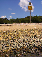Do Not Disturb sign on rocky beach<br />