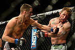 Las Vegas, NV - November 30, 2013: UFC lightweights, Gray Maynard  (white trunks) and Nate Diaz (Grey trunks) during their fight at The Ultimate Fighter Finale at The Mandalay Bay Events Center inside the Mandalay Bay Resort and Casino in Las Vegas, NV. (Al Powers for ESPN)