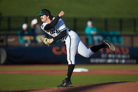 Coastal Carolina Chanticleers relief pitcher Alaska Abney (8) follows through on his delivery against the Illinois Fighting Illini at Springs Brooks Stadium on February 22, 2020 in Conway, South Carolina. The Fighting Illini defeated the Chanticleers 5-2. (Brian Westerholt/Four Seam Images)