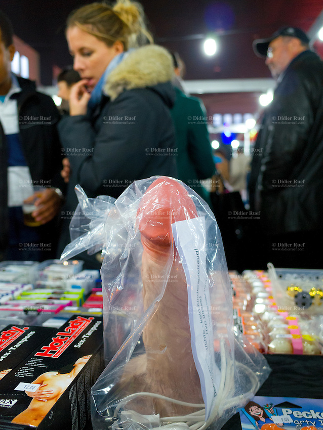Switzerland. Canton Ticino. Lugano. A giant phallus for sale and to be used as an electic table lamp. Extasia 2014 is the first erotic and sex fair in southern Switzerland. Sex toys on stall for sale. A sex toy is an object or device that is primarily used to facilitate human sexual pleasure, such as a dildo or vibrator. Many popular sex toys are designed to resemble human genitals and may be vibrating or non-vibrating. Sex toys are most commonly sold at a sex shop. 1.02.14 © 2014 Didier Ruef