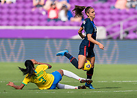 ORLANDO, FL - FEBRUARY 21: Alex Morgan #13 of the USWNT is fouled by Bruna #3 of Brazil during a game between Brazil and USWNT at Exploria Stadium on February 21, 2021 in Orlando, Florida.