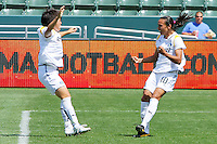 Aya Miyama #8 and Marta #10 of the Los Angeles Sol celebrate scoring a goal against FC Gold Pride during their match at Home Depot Center on April 19, 2009 in Carson, California.