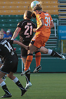 Carolyn Blank, of Sky Blue FC, heads the ball behind the Flash\'s Brittany Bock. The match was played June 3rd, in Rochester, NY, and ended in a 2-2 tie