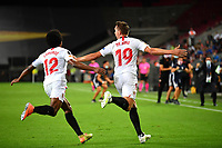 21st August 2020, Rheinenergiestadion, Cologne, Germany; Europa League Cup final Sevilla versus Inter Milan;  Luuk de Jong of Sevilla FC celebrates with team mate Jules Kounde after scoring his team's second goal for 2-1