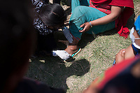 A volunteer medical team gives treatment to the injured earthquake victims at Sudal, outside of Kathmandu, Nepal. May 05, 2015