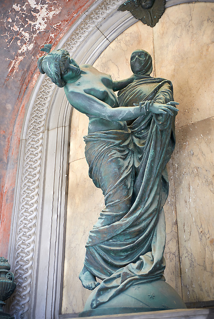 Picture and image of the bronze sculpture of a women dancing with a shrouded corpse. The Celle Tomb sculpted by G Monteverde in 1893. Section D, no 22, The monumental tombs of the Staglieno Monumental Cemetery, Genoa, Italy