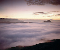 Above the clouds on Mount Bromo, looking into the Sea of Mist at dawn, Java, Indonesia