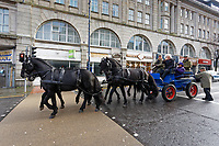 Pictured: Brian May on a horse cart travels through Castle Street in Swansea. Thursday 26 December 2019<br /> Re: Guitarist Brian May of Queen has joined the Boxing Day Hunt in Wind Street, Swansea, Wales, UK.