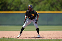 Pittsburgh Pirates Jasiah Dixon (25) leads off first base during a Minor League Spring Training intrasquad game on April 21, 2021 at Pirate City in Bradenton, Florida.  (Mike Janes/Four Seam Images)