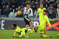 Calcio, Serie A: Juventus vs Bologna. Torino, Juventus Stadium, 8 gennaio 2017.<br /> Juventus' Paulo Dybala, center, is challenged by Bologna's Domenico Maietta, left, and Marios Oikonomou during the Italian Serie A football match between Juventus and Bologna at Turin's Juventus Stadium, 8 January 2017. Juventus won 3-0.<br /> UPDATE IMAGES PRESS/Manuela Viganti