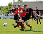 Eoin Hayes of Newmarket Celtic A in action against Darragh Fitgerald of Bridge United A during their Clare Cup Final at Frank Healy Park. Photograph by John Kelly.
