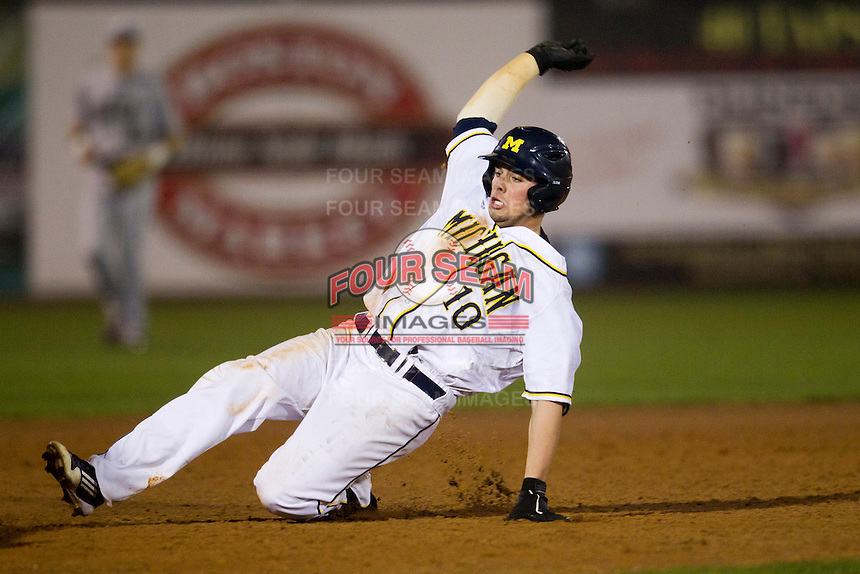 Michigan Wolverines outfielder Michael O'Neill #10 slides into third during a game against the Pittsburgh Panthers at the Big Ten/Big East Challenge at Florida Auto Exchange Stadium on February 18, 2012 in Dunedin, Florida.  (Mike Janes/Four Seam Images)