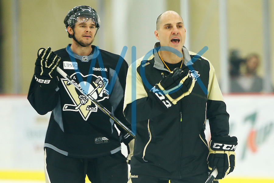 Assistant coach Rick Tocchet leads practice at UPMC Lemieux Sports Complex in Cranberry Township, Pennsylvania on April 26, 2016. (Photo by Jared Wickerham / DKPS)