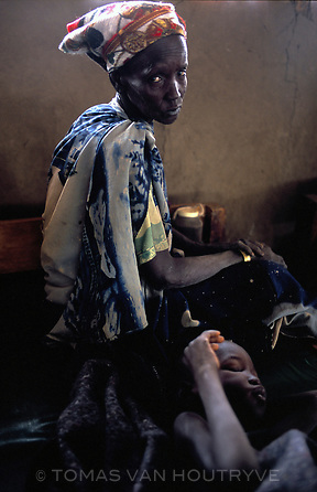 A Nuer woman looks over her child that is being treated for the disease kala azar at a Medecins Sans Frontiers Belgium health clinic in the village of Walgak in the Upper Nile region of South Sudan on Nov. 24, 2004.