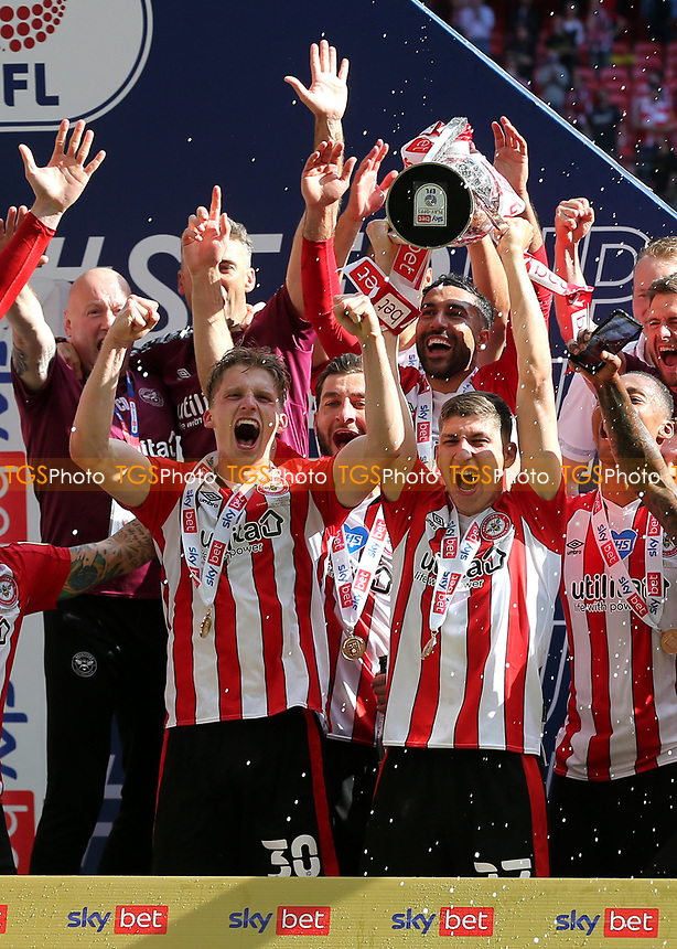 Vitaly Janelt lifts the Championship Trophy aloft as Brentford celebrate promotion to the Premier League during Brentford vs Swansea City, Sky Bet EFL Championship Play-Off Final Football at Wembley Stadium on 29th May 2021