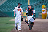 Fresno Grizzlies starting pitcher Mike Hauschild (30) and catcher Tim Federowicz (26) walk to the dugout before a Pacific Coast League game against the Salt Lake Bees at Chukchansi Park on May 14, 2018 in Fresno, California. Fresno defeated Salt Lake 4-3. (Zachary Lucy/Four Seam Images)