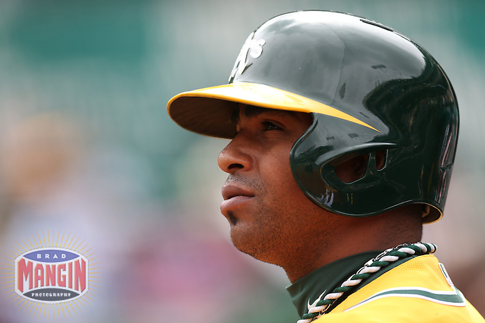 OAKLAND, CA - APRIL 4:  Yoenis Cespedes #52 of the Oakland Athletics waits in the on deck circle during the game against the Seattle Mariners at O.co Coliseum on April 4, 2013 in Oakland, California. Photo by Brad Mangin