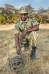 Park scout, Victor Samalumo, in anti-poaching patrol with confiscated snares, Kafue National Park, Zambia