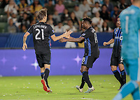 CARSON, CA - SEPTEMBER 21: Lassi Lappalainen #21 and Orji Okwonkwo #18 of the Montreal Impact celebrates Lassi's goal during a game between Montreal Impact and Los Angeles Galaxy at Dignity Health Sports Park on September 21, 2019 in Carson, California.