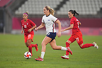 KASHIMA, JAPAN - AUGUST 2: Lindsey Horan #9 of the United States dribbles the ball during a game between Canada and USWNT at Kashima Soccer Stadium on August 2, 2021 in Kashima, Japan.