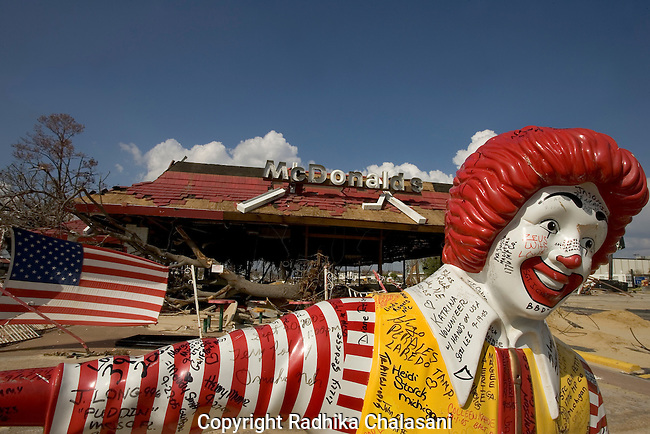 Biloxi - October 02: Graffiti adorns a Ronald McDonald statue in front of a destroyed McDonalds October 02, 2005 in the  wake of the disaster caused by Hurricane Katrina in Biloxi, Mississippi.  (Photo by Radhika Chalasani)