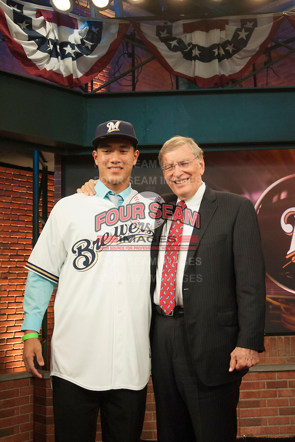 Pitcher Kodi Medeiros (Waiakea H.S. (HI)) the number 12th overall pick to the Milwaukee Brewers with Commissioner Bud Selig during the MLB Draft on Thursday June 05,2014 at Studio 42 in Secaucus, NJ.   (Tomasso DeRosa/ Four Seam Images)