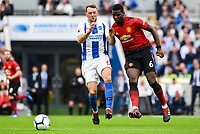 Dale Stephens of Brighton & Hove Albion (6)  and Paul Pogba of Manchester United (6)  during the Premier League match between Brighton and Hove Albion and Manchester United at the American Express Community Stadium, Brighton and Hove, England on 19 August 2018. Photo by Edward Thomas / PRiME Media Images.