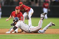 Jun. 9, 2009; Phoenix, AZ, USA; Arizona Diamondbacks shortstop Stephen Drew tags out San Francisco Giants base runner Kevin Frandsen at Chase Field. Mandatory Credit: Mark J. Rebilas-