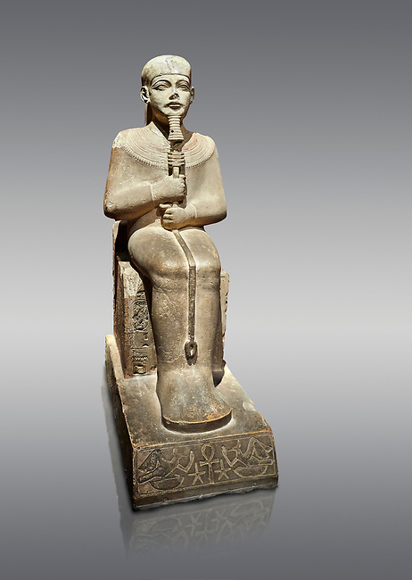 """Ancient Egyptian statue of Ptah - limestone - New Kingdom. 18th Dynasty, reign of Amenhotep III (1390 - 1353 BC), Karnac. Egyptian Museum, Turin.  Grey background<br /> <br /> Large statue of Egyptian gods are rare and most of them are part of building designs. This imposing statue of Ptah was probably made for the """"Temple of Millions of Years"""", on the west bank of Thebes, promoted by Amenhotep III . When the temple was eventually abandoned its statues were reused in other temples in the region. Drovetti collection C. 87"""