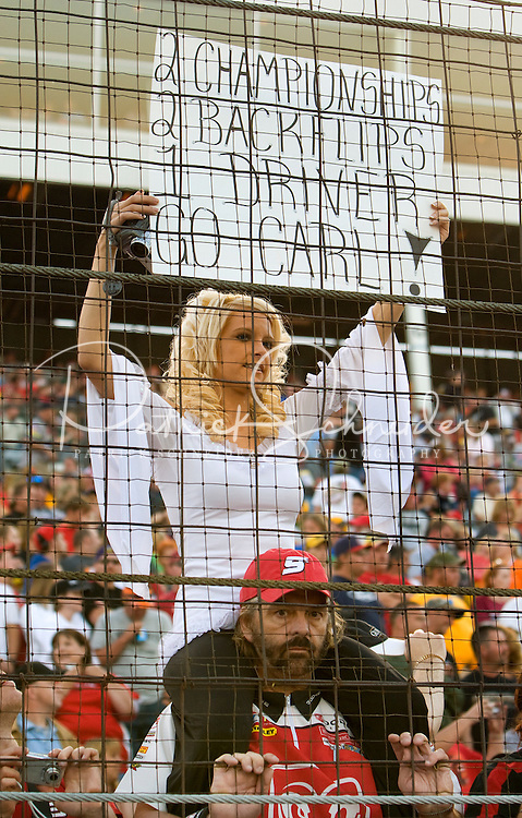 A woman shows her support for Carl Edwards during the Bank of America 500 NASCAR race at Lowes's Motor Speedway in Concord, NC.