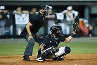 Danville Otterbots catcher Kellen Sarver (17) (Illinois) frames a pitch as the home plate umpire looks on at Burlington Athletic Park on June 5, 2021 in Burlington, North Carolina. (Brian Westerholt/Four Seam Images)