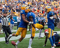 Pitt defensive back Therran Coleman (4) celebrates his interception in overtime along with Elijah Zeise (25) and Damar Hamlin (3).The Pitt Panthers defeated the Syracuse Orange 44-37 in overtime at Heinz Field in Pittsburgh, Pennsylvania on October 6, 2018.