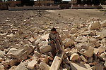 A young boy from the northern Syrian town of Az'az  surveys the remains of a mosque destroyed by heavy fighting on early August, 2012...© Javier Manzano