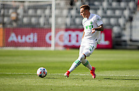 LOS ANGELES, CA - APRIL 17: Žan Kolmanič #21 of Austin FC passes off the ball during a game between Austin FC and Los Angeles FC at Banc of California Stadium on April 17, 2021 in Los Angeles, California.