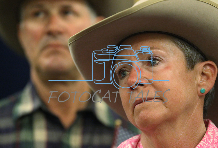 Eddyann and Dan Filipini listen to Gov. Brian Sandoval speak to a group of ranchers at the Capitol in Carson City, Nev., on Friday, May 30, 2014. About 40 people rode horses into downtown Carson City today to deliver a petition to the governor calling attention to the ongoing fight between ranchers and the BLM over grazing on public lands. <br /> Photo by Cathleen Allison