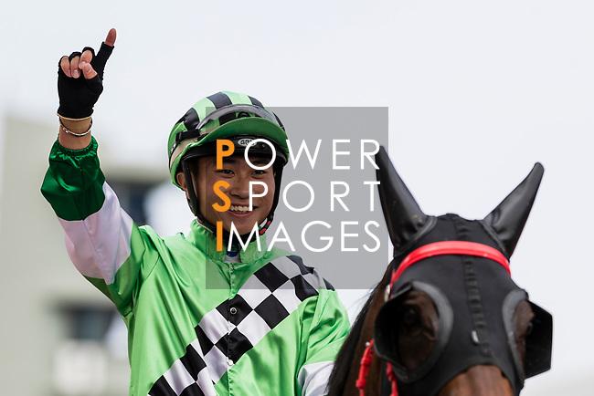 Jockey Dylan Mo Hin-tung riding #6 Green Energy celebrates after winning the race 5 during Hong Kong Racing at Sha Tin Racecourse on October 01, 2018 in Hong Kong, Hong Kong. Photo by Yu Chun Christopher Wong / Power Sport Images