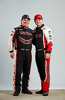 Feb 20, 2020; Chandler, Arizona, USA; NHRA top fuel driver Billy Torrence (left) and son Steve Torrence pose for a portrait during the Arizona Nationals at Wild Horse Pass Motorsports Park. Mandatory Credit: Mark J. Rebilas-USA TODAY Sports