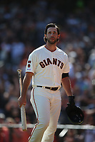 SAN FRANCISCO, CA - SEPTEMBER 29:  Madison Bumgarner #40 of the San Francisco Giants walks back to the dugout after his at bat against the Los Angeles Dodgers during the game at Oracle Park on Sunday, September 29, 2019 in San Francisco, California. (Photo by Brad Mangin)