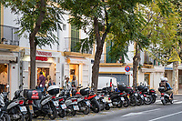 Scooters and shops, Ibiza Town, Balearic Islands, Spain.